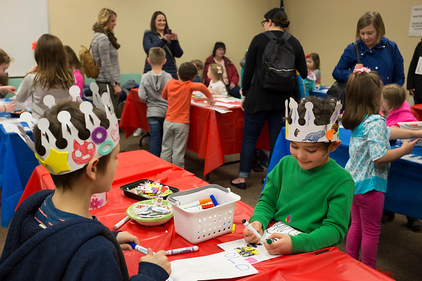 JOED VIERA/STAFF PHOTOGRAPHER-Caden Edwards, 8, and Leif Maish, 6, color crafts during the Lockport Public Library's 125th year anniversary kick-off event Thursday. afternoon.