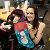 CONTRIBUTED- Samantha Young and her 6mo old daughter enjoy the festivities during the Kiwanian Christmas Party at Brad Angelo Lanes.