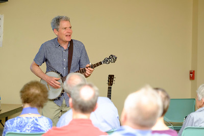 JOED VIERA/STAFF PHOTOGRAPHER-Lockport, NY-Dave Ruch plays his banjo during his demonstration at the Lockport Public Library.