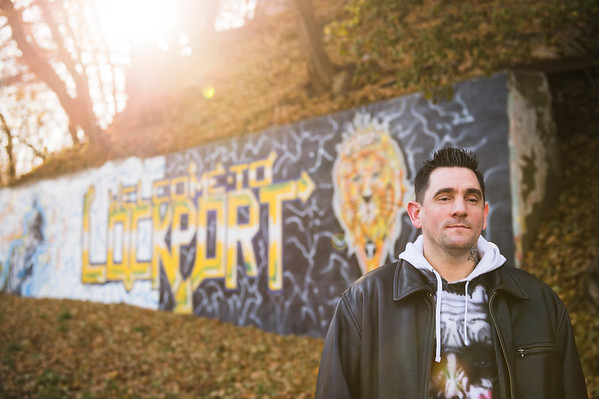 Joed Viera/Staff Photographer-Jeffrey Sidebottom in front of his Clinton Street Mural.