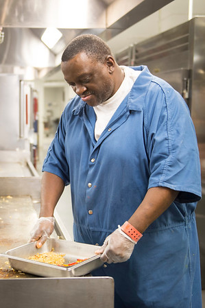 Joed Viera/Staff Photographer- Kenny Moore prepares onions and peppers in the Niagara County Jail kitchen during F-Bites.