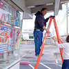JOED VIERA/STAFF PHOTOGRAPHER-Lockport, NY-Tasty Treat owners John and Nanette Frey replace lights outside of their ice cream stand ahead of their 18th season in business. Tasty Treat traditionally open on the first Thursday in March which falls on the 8th this year.