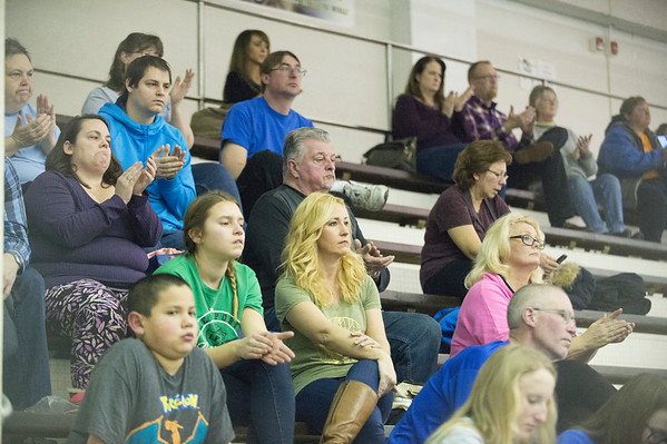 Joed Viera/Staff Photographer- A crowd watches the NFL diving championship at Lockport High School Friday evening.