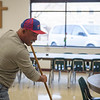 Joed Viera/Staff Photographer-Miguel Baez cleans up the Salvation Army's Sister Mary Loretto Soup Kitchen Thursday afternoon.