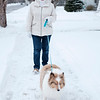 Joed Viera/Staff Photographer-A Newfane resident walks her dog down East Ave Wednesday Afternoon. The Town's board recently voted on a new canine ordninace.