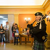 JOED VIERA/STAFF PHOTOGRAPHER-Lockport, NY- Bagpiper and Organ recipient Joseph Baschnage plays as the donate life flag is draped at the Niagara County Courthhouse.