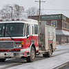 Joed Viera/Staff Photographer- A Lockport City fire engine drives down a snowy Chestnut Street.