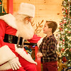 Joed Viera/Staff Photographer-Jayden Kasperek meets Santa Claus in his Christmas Cottage at Day Road Park Thursday evening.