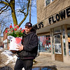 JOED VIERA/STAFF PHOTOGRAPHER-Lockport, NY-Aaron Tatu walks out of Goulds Flowers with a bouquet of roses for his sweetheart.
