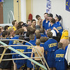 Joed Viera/Staff Photographer-The Lockport swimming team get pumped before their meet.