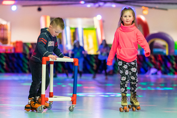 Joed Viera/Staff Photographer-Samuel and Ava Drabinski stroll around Rainbow Skateland Friday afternoon.