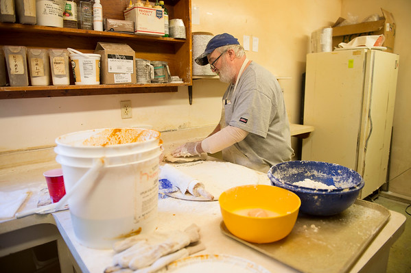 Joed Viera/Staff Photographer- <br /> Bob Hall makes pies at Halls Apple Farm Tuesday morning in preperation for his annual Thanksgiving rush. Hall says he's started making pies Monday night and sees no end to work in sight.