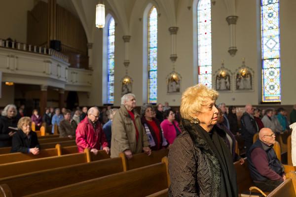 JOED VIERA/STAFF PHOTOGRAPHER-Lockport, NY-Parishioners attend Ash Wednesday service at All Saints Roman Catholic Parish.