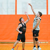 Joed Viera/Staff Photographer-Wilson seniors Macgregor Musall and Nathaniel Fox play a one on one game during practice on Monday night.