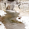 JOED VIERA/STAFF PHOTOGRAPHER-Lockport, NY- Ice and snow melts into the East Branch of Eighteenmile Creek at the south end of Quaker Road in Gasport. Weather forecasts call for more snow this evening.