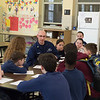 JOED VIERA/STAFF PHOTOGRAPHER-Lockprot, NY-Coast Guardsmen Eric Mazurek speaks with Desale students during their career fair.