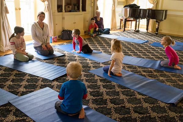 Joed Viera/Staff Photographer-Kids participate in Brandi Silsby's Snowga, a snow and winter themed yoga class, at the Kenan Center Thursday afternoon.