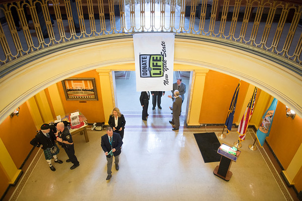 JOED VIERA/STAFF PHOTOGRAPHER-Lockport, NY- The Donate Life flag hangs  temporarily across the railings of the Niagara County Courthhouse rotunda. The flag will be raised on the Courthouse's flagpole today at 1pm.