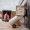 Joed Viera/Staff Photographer- <br /> Annette Wittcop, Manuel Gutierrez and Jaime Szymanski bring in the day's delivieries into the Sister Mary Loretto Soup Kitchen at the Salvation Army Monday morning.