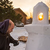 JOED VIERA/STAFF PHOTOGRAPHER-Newfane, NY-Jay Hughes sculpts a lighthouse out of snow in front of his Newfane home on Lockport Olcott Road. Hughes, a mason by trade said he pick up the hobby to keep busy during the winter when work slows down. To see the finished snow sculpture for yourself  take a trip to the Newfane water tower and look across the street.