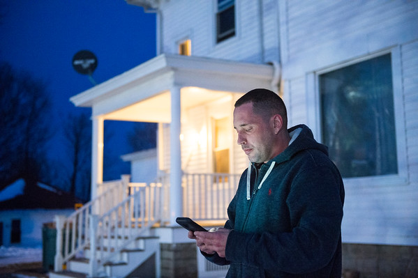 JOED VIERA/STAFF PHOTOGRAPHER-Somerset, NY-David Wisniewski searches for a phone signal outside the Somerset House, a community residence for women with a substance use disorder. The facility is located in a part of Niagara County that has yet to receive broadband services. Wisniewski says he relies on his smartphone to get online.