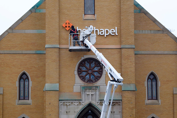 Joed Viera/Staff Photographer-A Ulrich Signs worker installs new lettering for The Chapel on the former St Mary's Church.