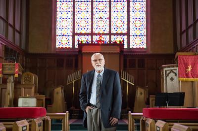 JOED VIERA/STAFF PHOTOGRAPHER-Lockport, NY- Rev. Dr. Duane Priset stands between the pews at Emmanuel United Methodist Church.