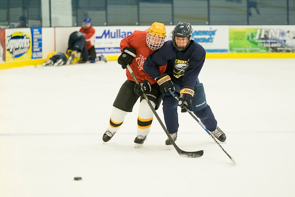 Joed Viera/Staff Photographer-Jeremy McDonald, right, battles  another player for the puck during the Skate N Shoot at Cornerstone Arena Firday Afternoon.