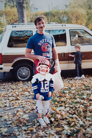 JOED VIERA/STAFF PHOTOGRAPHER-Lockport, NY-Matt Devine with his father Mark before going to a Bills game in the 90's