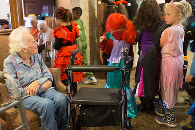 JOED VIERA/STAFF PHOTOGRAPHER-Lockport, NY-Heritage Manor resident Mary Bennett checks out students Halloween costumes during  their trip to facility from Roy B. Kelly