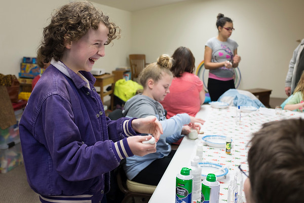 JOED VIERA/STAFF PHOTOGRAPHER-Lockport, NY-Alex Gagne 12 plays with slime at the Middleport Community Library.
