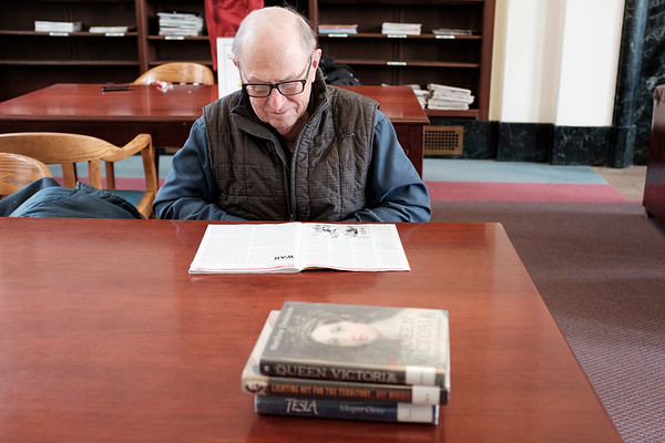 Joed Viera/Staff Photographer-Bruce Giles looks through a magazine at the Lockport Public Library.