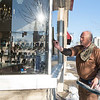 JOED VIERA/STAFF PHOTOGRAPHER-Lockport, NY-Bill Laskey wipes windows at Scirto's Jewelers. Laskey has been cleaning windows for over 40 years.
