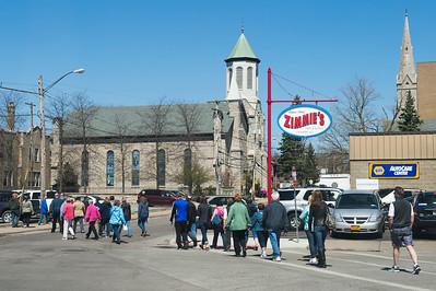 JOED VIERA/STAFF PHOTOGRAPHER-Lockport, NY-Participants follow the cross along Church Street during the crosswalk from Lockport United Church of Christ to First Presbyterian Church.