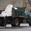 JOED VIERA/STAFF PHOTOGRAPHER-Lockport, NY-Snow falls out of a city dump truck while turning onto Niagara Street.