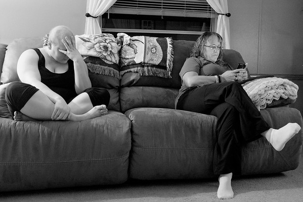JOED VIERA/STAFF PHOTOGRAPHER-Lockport, NY-   Katie Jo Perry waits as her mother texts family to join her for a prayer circle, the night before her surgery.