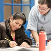 Joed Viera/Staff Photographer- Wendy Farley checks out Lisa Morales' work on her punctuation worksheet during the ESOL class at BOCES.
