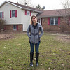 JOED VIERA/STAFF PHOTOGRAPHER-Emily Christiansen outside her Mack Road home. Christiansen's home is one of many rural properties across the county that lacks the infustructure to obtain a broadband connection.