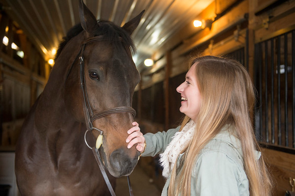 Joed Viera/Staff Photographer-Madeline Keyes pets her quarterhorse Jackson.