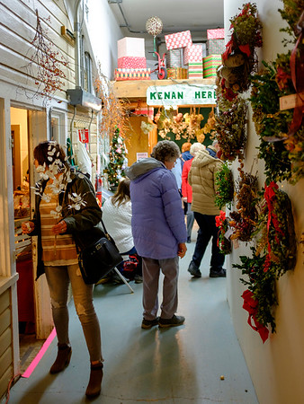 Joed Viera/Staff Photographer- Patrons browse for gifts at the Kenan Center's annual Holiday Gift Show Friday night. The Show continues today from 11 AM-5 PM.