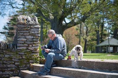 JOED VIERA/STAFF PHOTOGRAPHER-Olcott, NY-Dave DePonceau and his dog Luca take a break on the steps at Olcott Beach.
