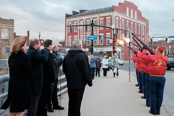 Joed Viera/Staff Photographer- A cold Big Bridge crowd watches as the Lockport Devil Dogs fire rifles during a commemoration put on by the Navy Club in honor Pearl Harbor Day.