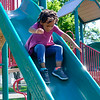 JOED VIERA/STAFF PHOTOGRAPHER-Lockport, NY-Karisma Joyner, 3, takes a ride down a slide at Altro Park on Willow Street.