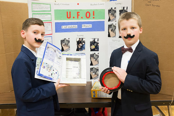 "Joed Viera/Staff Photographer-Inventors Brady Crissman, 10, and Reuben Lowry, 9, show off their product line, U.F.O. at Starpoint's Inventathon.  U.F.O. is for people looking to hide their portable devices in plain sight. ""Whose gonna look in a science book?"" said Crissman."