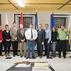 Joed Viera/Staff Photographer-Veterans of Foreign Wars post 2535 welcomed guests who donated $1,000 in new military flags to their meeting Wenesday night. (pictured from left) Gordon Bellinger from the Pendleton Veterans Association, Dave and Jennifer Giansante from GiRo's Cleaners, Senior Vice Commander Jay Symes, Kenny Gutowski from the Elks Lodge, VFW Commander Roger Cordle , NY Senator Robert Ortt, Mark Bannon from the Davidson Road Inn, Sue Griffin from the Ladies Hibernians, VFW member Al Lynch and Tom Lupo of the Lockport Fire Department.  In a suprising move  Ortt gave the VFW a NY State flag that flew over Washington D.C. on Flag Day.