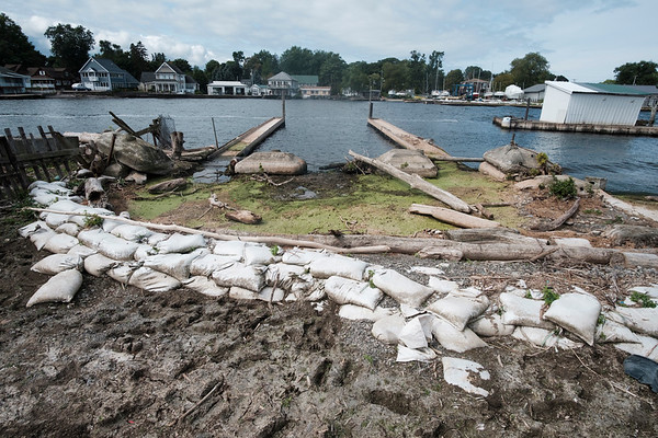 Joed Viera/Staff Photographer-In this August 24th file photo Sand bags struggled to hold back Lake Ontario's recent high water levels from damaging Hedley Boat Company in Olcott N.Y.  The Boat Company has been in the Hedly family for a hundred years.