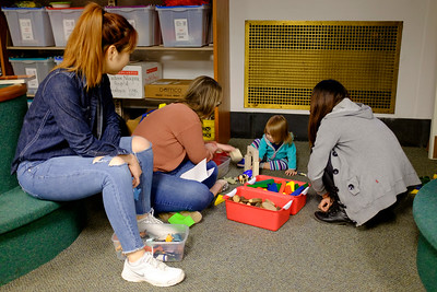 JOED VIERA/STAFF PHOTOGRAPHER-Niagara University students Natalie Park, Blakely King and  Hoa Hoa play with Alice Stefanko, 2, during Books, Balls & Blocks, an literacy outreach program funded by the United Way of Greater Niagara. At the event kids were treated to snacks and games before leavign with copies of bi-lingual books.