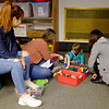 JOED VIERA/STAFF PHOTOGRAPHER-Niagara University students Natalie Park, Blakely King and <br /> Hoa Hoa play with Alice Stefanko, 2, during Books, Balls & Blocks, an literacy outreach program funded by the United Way of Greater Niagara. At the event kids were treated to snacks and games before leavign with copies of bi-lingual books.