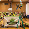 Joed Viera/Staff Photographer Lockport, NY-Starpoint Middle School students watch BMX performer Colton Civitello jump a ramp as a reward for participating in the school's Pick a Reading Partner Program