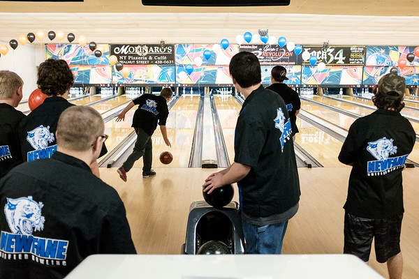 Joed Viera/Staff Photographer-Newfane High School's unified bowlers watch as their Teammate Zachary Murray launches his ball down lane 5 during the section VI unified sports bowling tournament at Brad Angelo Lanes.